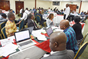 Participants grouped objective-wise to fill the MLE forms and data collection tools at the TL III MLE workshop. Photo: ICRISAT