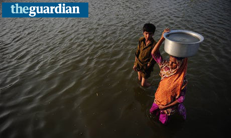 A Pakistani woman carries drinking water on her head. Photograph: Asif Hassan/AFP/Getty Images