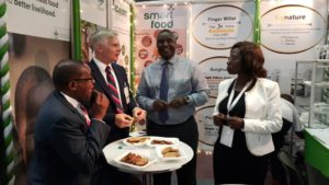 Tasting Smart Food delicacies at the booth with (far left) Kenya's former Agriculture Secretary Dr Wilson Songa and his wife Josephine (far right) and Moses Siambi.
