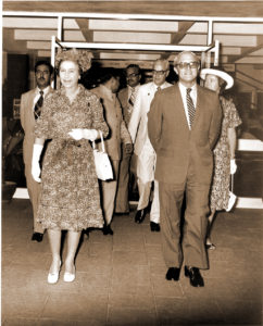 Director General Leslie D Swindale escorts Queen Elizabeth into ICRISAT.
