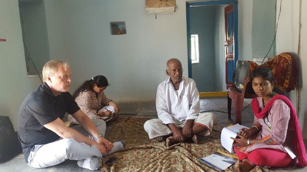 Dasta Reddy (center) making observations on the changes in his village. Photo: S Nedumaran, ICRISAT