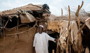 Nouhoun Tigana guards a chicken coop in Kolondialan, central Mali. Photo: Alex Potter, Thomson Reuters Foundation