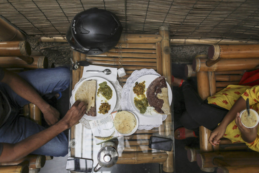 Customers eat millet food at Vaathsalya Millet Cafe in Bengaluru, India. Photo: Dhiraj Singh, Bloomberg