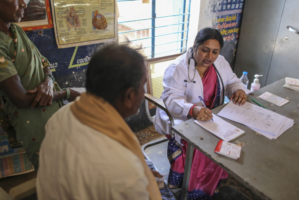 Vinaya A.S. with patients at a mobile clinic on the outskirts of Bengaluru. Photo: Dhiraj Singh, Bloomberg