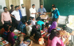 Distribution of peanut-based food supplements among primary school children in Bangladesh. Photo: BARI