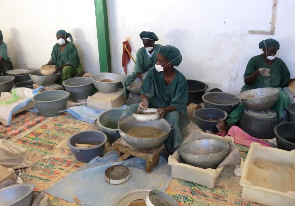Women work at La Vivriére, a Senegalese business that processes foods made from traditional grains, in Pikine, a suburb of Dakar. Photo: Root Capital