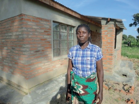 """""""With the seed sales I was able to start a small fritter business. I also bought some fertilizer for my maize field. The seed incomes kept my family food secure throughout the year, and we will soon move from our small thatch hut to my dream house, with concrete floor and solid iron sheet roof."""" Ms Mary Kumwenda, 2017."""