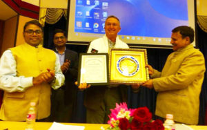 Dr Peter Carberry receiving the Honorary Fellowship by Indian Society of Pulses Research & Development (ISPRD)