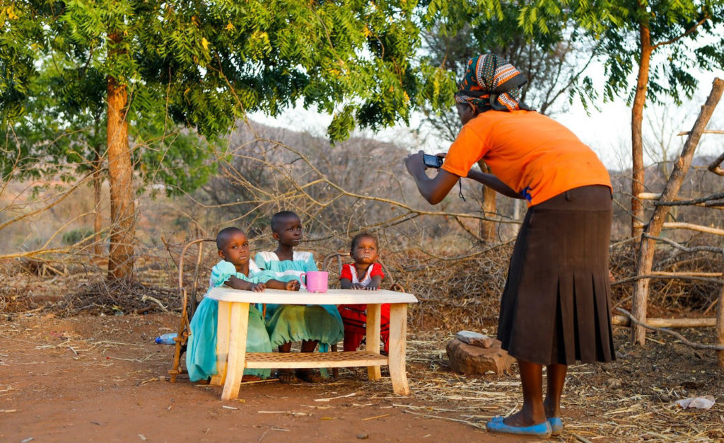 A young woman tries her hand at photography. Photo: C Wangari