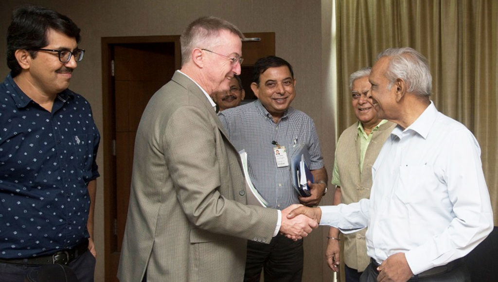 Dr Peter Carberry greeting Dr EA Siddiq at the meeting while (L-R) Dr Bhagirath Choudhary, Founder, SABC; Dr Govind Gujar, SABC; Dr Kiran Sharma; and Dr CD Mayee, President, SABC look on.  Photo: S Punna, ICRISAT