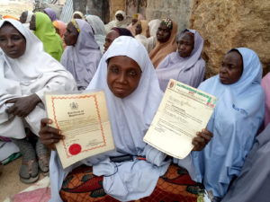 Mrs Idrissa showing the legal document of the creation of the Bunkure women's group in 2008 and a recognition of the Governor of Kano State for their contribution to the development of the community. Photo: A Diama, ICRISAT