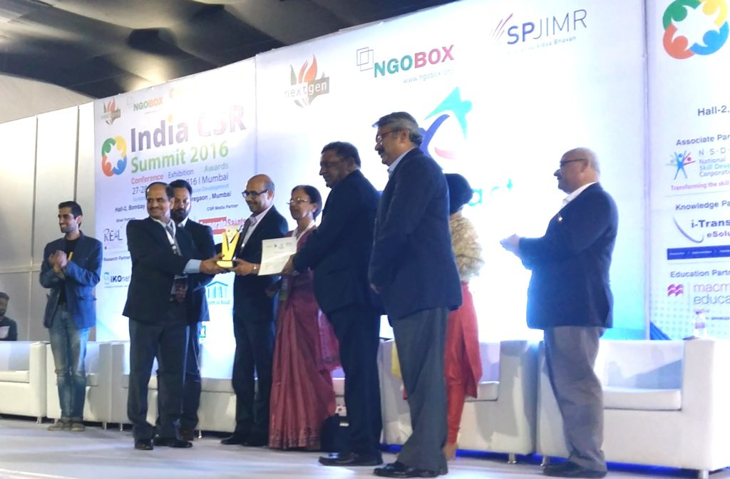 Dr Suhas P. Wani receiving the award along with Mr GJ Deshpande, Director - Technical JSW energy limited and Mr Mukund Gorakshkar, Executive Officer, JSW Foundation.