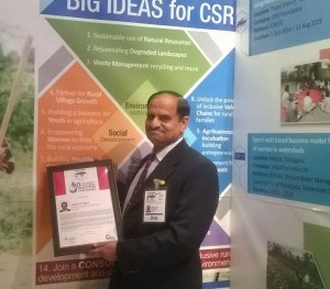 Dr Suhas Wani, Director ICRISAT Development Center with the award.