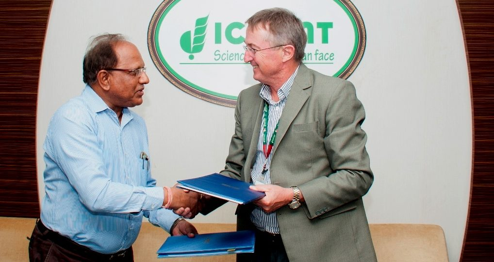 MoA being exchanged between Dr Peter Carberry, ICRISAT's Deputy Director General for Research (right ) and Dr PM Salimath Vice Chancellor UAS-R