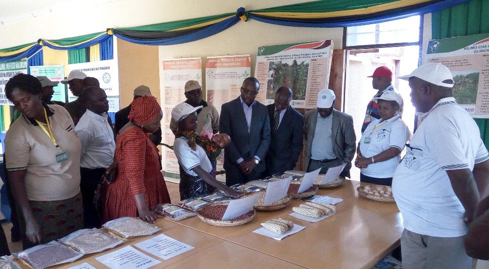 Mr Mavunde listening to a woman farmer explaining a new porridge recipe. Photo: ICRISAT