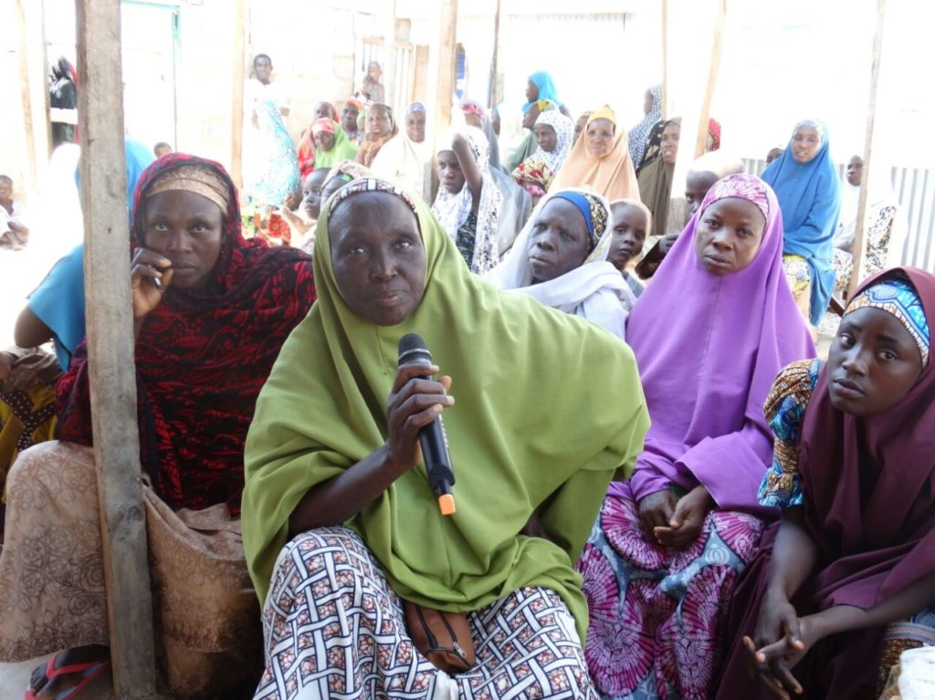 Leader of the women's group Mrs. Hadja Hauwa Audu (with a microphone) and other members of the Yadokori Women Community center in Garum Malam, supported by WOFAN, Nigeria.