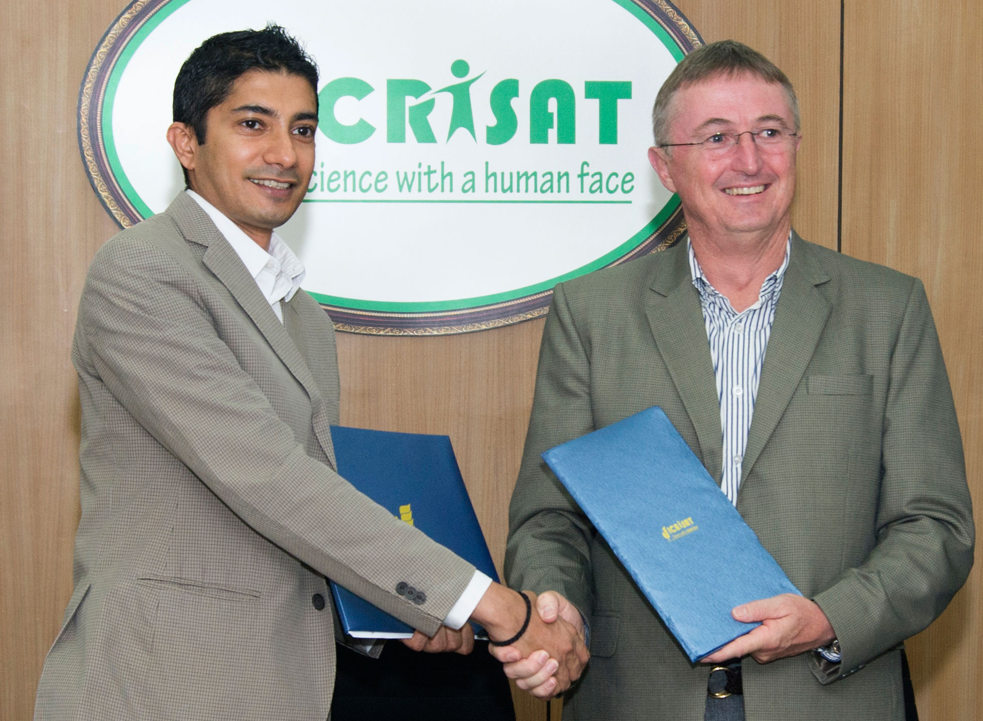 Mr Jay Krishnan, CEO T-Hub and Dr Carberry, exchange signed MoU. Photo: S Punna, ICRISAT