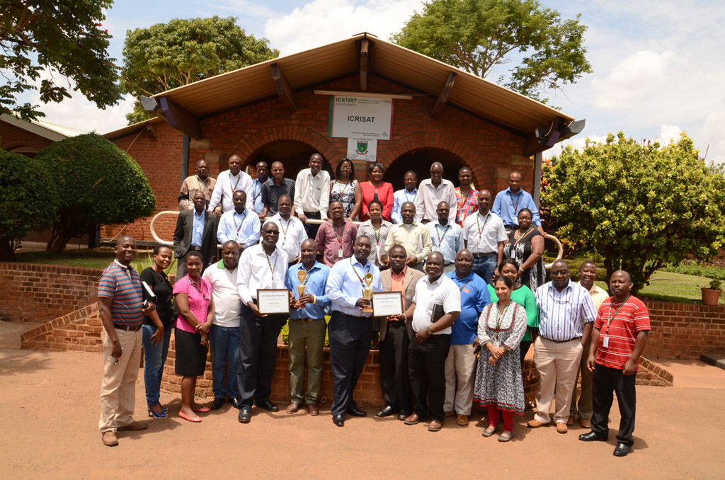 ICRISAT-Malawi staff celebrate the achievement along with Dr Okori, Dr Siambi and STAM representatives. Photos: ICRISAT, Malawi
