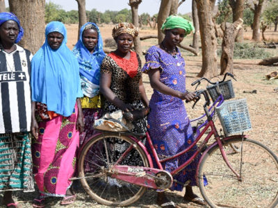 Ms Zombra Maimouna (with bicycle) and members of the Pagou women farmers group in Burkina Faso. Photo. A. Diama, ICRISAT.