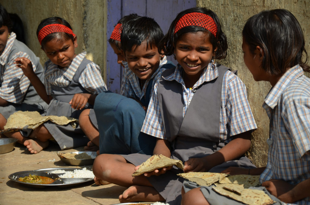 Young school children in rural India eating millet chappatis with rice and vegetable curry. Photo A. Paul-Bossuet, ICRASAT
