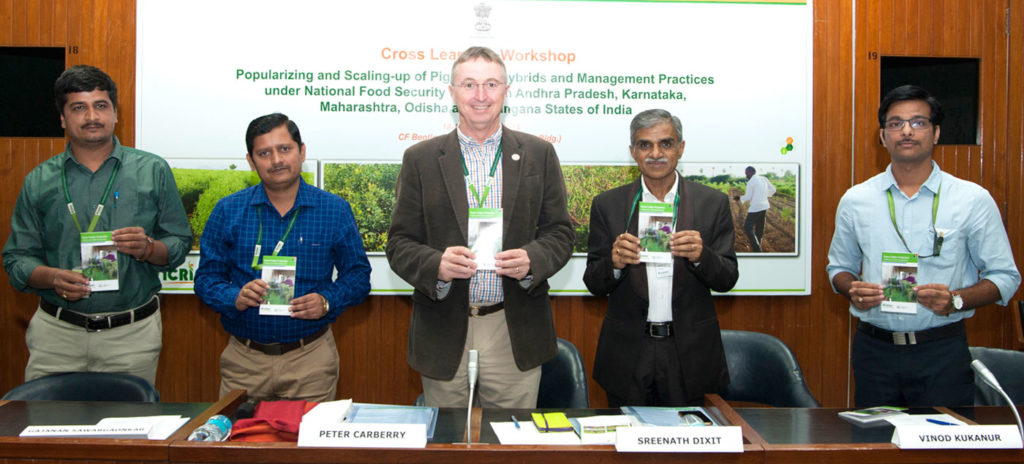 Dr Peter Carberry, Director General, ICRISAT, releases a booklet on good agricultural practices for pigeonpea, along with (L-R) Dr Prakash Kothari, Visiting Scientist, ICRISAT; Dr Gajanan Sawargaonkar, Senior Scientist, ICRISAT Development Center; Dr Peter Carberry; Dr Sreenath Dixit, Head, IDC; and Dr Vinod Kukanur, Visiting Scientist, ICRISAT. Photo: PS Rao, ICRISAT