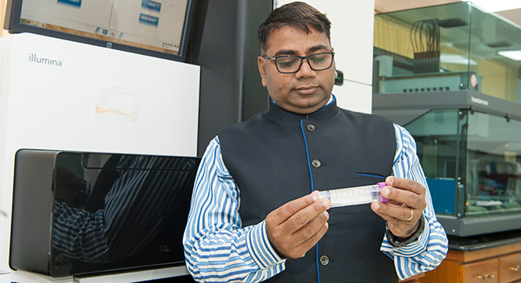Dr. Rajeev Varshney, the project leader, inspecting a flowcell used for sequencing at the Center of Excellence in Genomics & Systems Biology, ICRISAT (cegsb.icrisat.org)