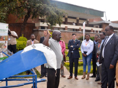 One of the technologies developed by MISST being demonstrated to Dr Alexander Bulilani, Controller of Agriculture and Extension Services (3rd from right). Photo: Stuart Mkuwamba, ICRISAT