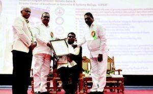 Dr Praveen Rao, Vice-Chancellor, PJTSAU (L), Mr S Niranjan Reddy, Hon'ble Minister of Agriculture, Telangana (C) and Mr T Prakash Goud, MLA Rajendranagar (R) felicitating Dr Varshney. Photo: PJTSAU
