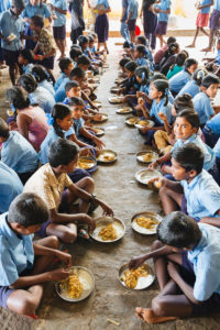 Children during a meal at a school in India.