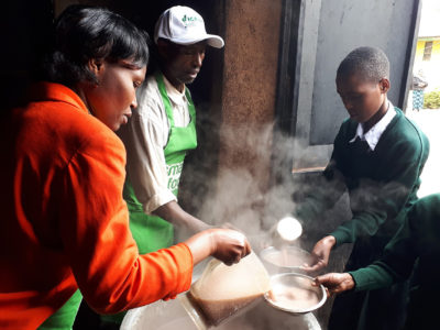 Children in Tanzania being served finger millet porridge as part of the Smart Food initiative in Africa