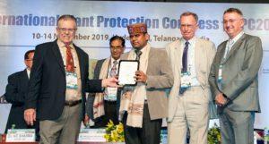 Dr Rajan Sharma, Head, Plant Quarantine Unit at ICRISAT, accepting an award for scientific achievement at IPPC2019. Photo: PS Rao, ICRISAT