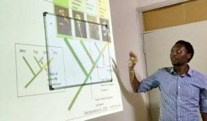 Professor Runo explaining Striga. Photo: CRP-GLDC