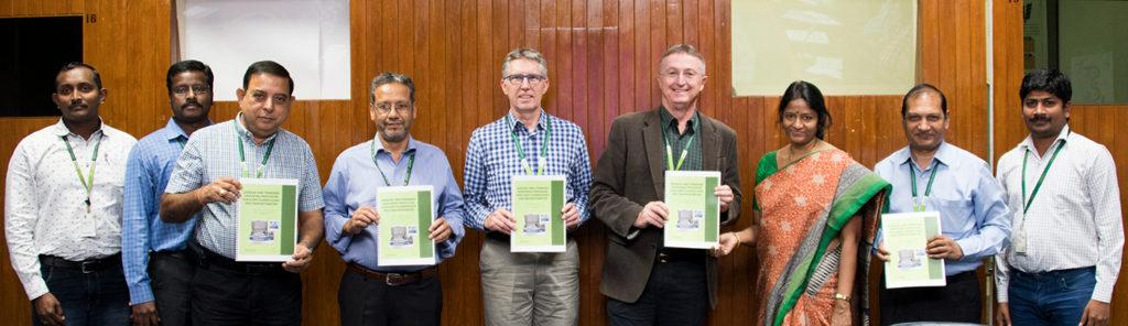 (L–R): Mr H Shivade, Scientific Officer, ICRISAT; Dr M Govindaraj, Sr Scientist, Pearl Millet Breeding, ICRISAT; Dr KK Sharma, Dep Director General-Research, ICRISAT; Dr Parminder Virk, Head, Crop Development, HarvestPlus; Dr Jan Debaene, Global Head, Breeding, ICRISAT; Dr Peter Carberry, Director General, ICRISAT; Dr Tara Satyavathi, Project Coordinator, ICAR-AICRPPearl Millet; Dr Pooran Gaur, Head, Research Program Asia, ICRISAT; and Dr A Kanatti, Visiting Scientist, ICRISAT; with copies of the XRF Manual and Standard Operating Procedures booklet.