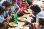 Children eating millet meals at school. Photo: Liam Wright, ICRISAT