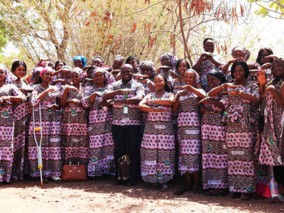 The staff posing with the theme gesture of the International Women's Day 2020. Photo: ICRISAT