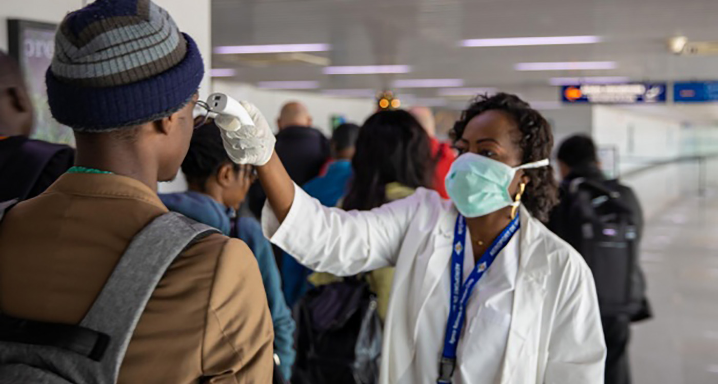 Passenger screening at Maya Maya International airport, Brazzaville, Republic of Congo. Response teams are racing against the spread of COVID in Africa. Photo: D. Elombat (WHO)