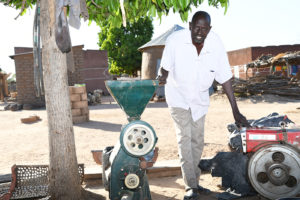 Farmer Bourama with his thresher. Photos: N Diakite and S Touré, ICRISAT