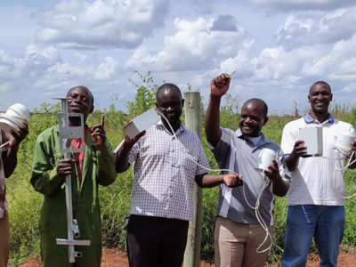 Photo: Installation of cheap, recyclable IoT rain gauges prototypes conceived by Manobi Africa and Viveris to reduce basis risk, insurance premiums and interest rates on smallholder credit. Photo: PCS Traore, ICRISAT