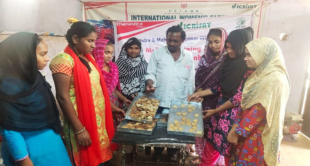 Women learn to make millet-based food products. Photo: ICRISAT