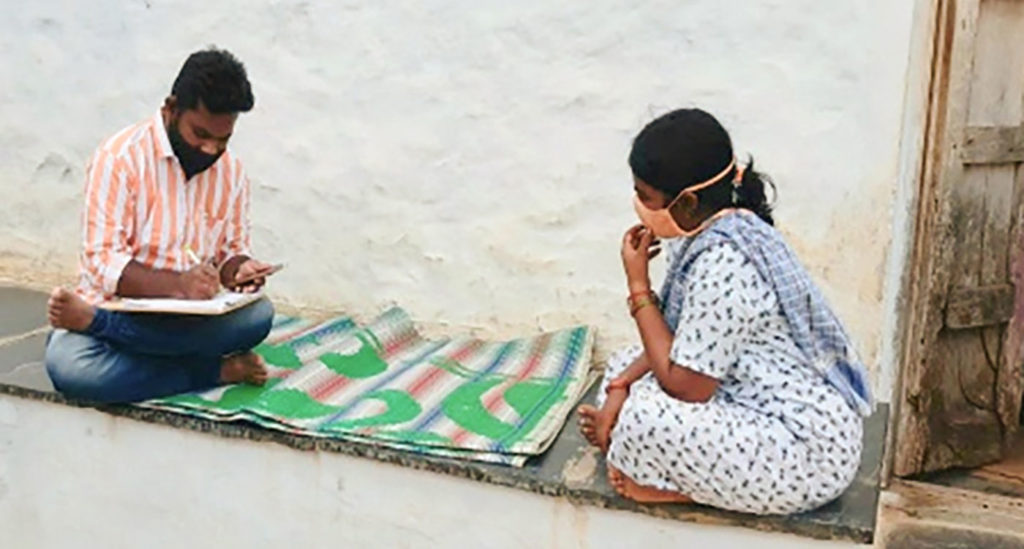 A survey team member interviewing a farmer in Ananthapuramu, Andhra Pradesh.