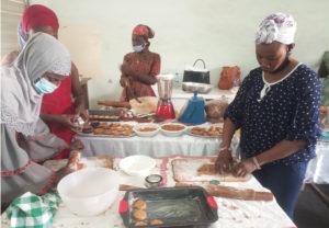Participants preparing groundnut dishes during the training. Photo: D Adogoba, CSIR-SARI