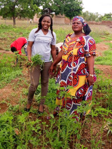 Ms Kafando Koutou Assetou with a young visitor passionate about agriculture.