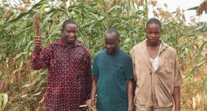 Mr Noyeza Bonzi (far left) with ICRISAT staff and his son Augustin. Photos: M. Magassa, ICRISAT