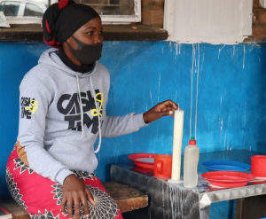Testing milk for quality at delivery, Bumbwe cooperative. Photo: Louis Suwedi